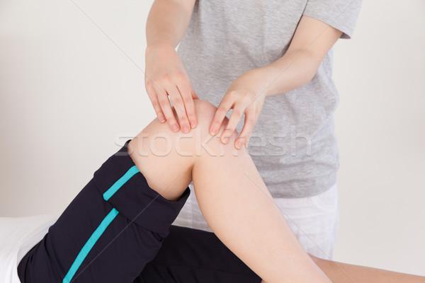 Masajista rodilla mujer mujeres Foto stock © wavebreak_media