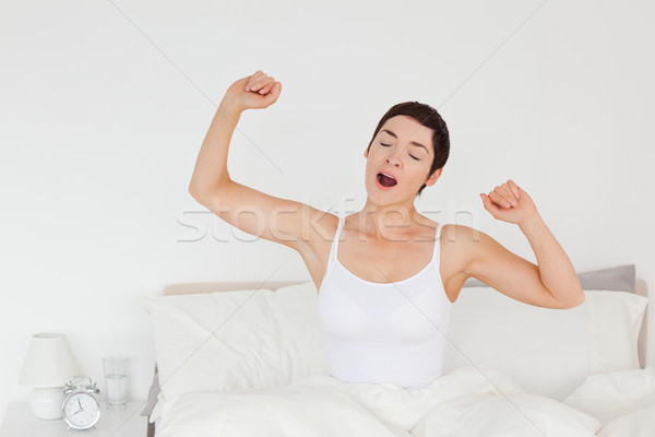 Close up of a woman stretching her arms to wake up Stock photo © wavebreak_media