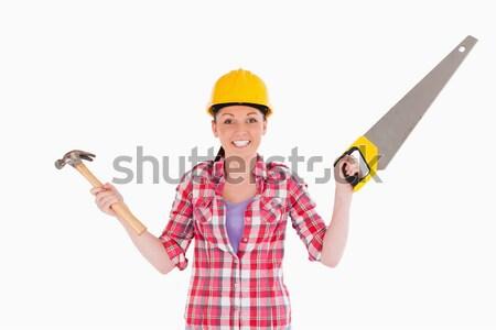 Mujer atractiva vio martillo pie blanco Foto stock © wavebreak_media