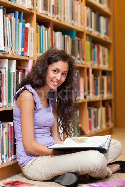 Portrait of a female student with a book in a library Stock photo © wavebreak_media