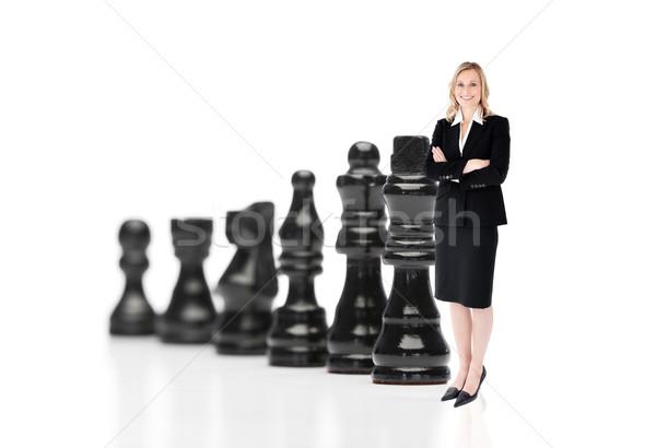 Mujer de negocios negro piezas de ajedrez blanco deporte éxito Foto stock © wavebreak_media