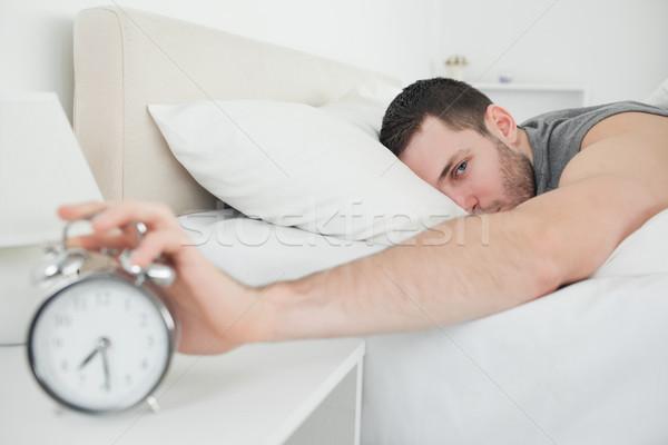 Stock fotó: Vonzó · férfi · ébresztőóra · hálószoba · üzlet · arc