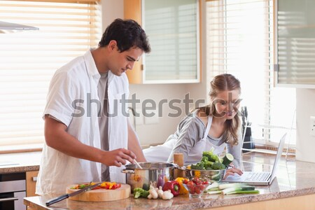 Young couple using the internet to look up recipe Stock photo © wavebreak_media