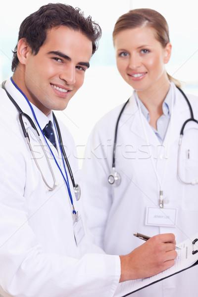 улыбаясь молодые медицинской сотрудников работу здоровья Сток-фото © wavebreak_media