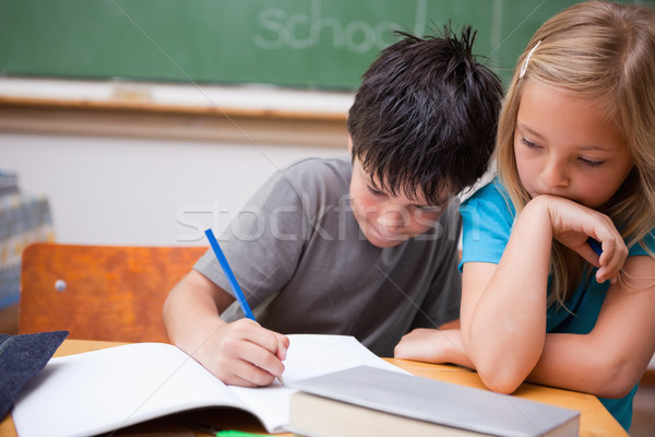 Serious pupils working together in a classroom Stock photo © wavebreak_media