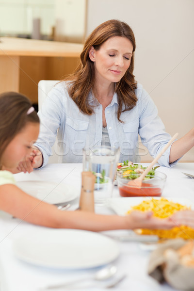 Praying family about to have dinner together Stock photo © wavebreak_media