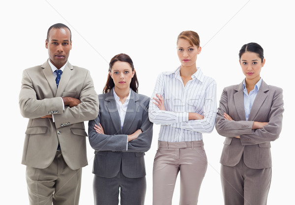 Business team side by side crossing their arms against white background Stock photo © wavebreak_media