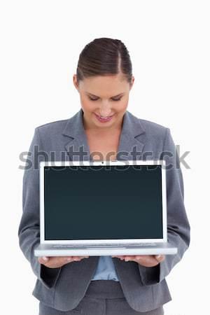 Gülen aşağı bakıyor dizüstü bilgisayar beyaz iş çalışmak Stok fotoğraf © wavebreak_media