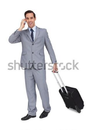 Uśmiechnięty handlowiec walizkę kurtka biały człowiek Zdjęcia stock © wavebreak_media
