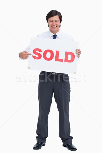 Sonriendo masculina senalando vendido signo Foto stock © wavebreak_media