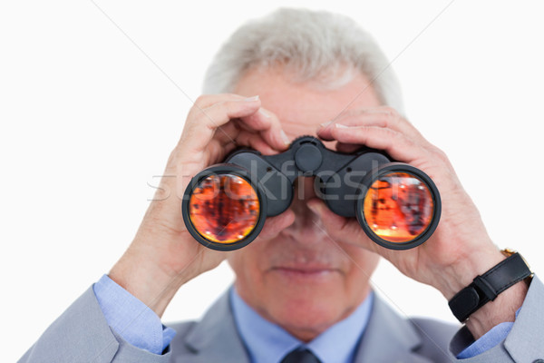 Close up of mature tradesman looking through spy glass against a white background Stock photo © wavebreak_media