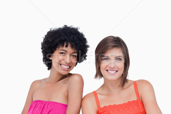 Two happy friends standing upright side by side on the white background Stock photo © wavebreak_media