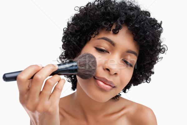 Genç dikkatlice makyaj toz siyah Stok fotoğraf © wavebreak_media