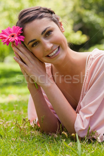 Woman lying on her front with her head turned towards her side as she rests her head against her arm Stock photo © wavebreak_media