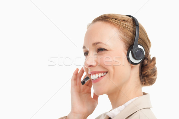 Pretty woman in a suit with headset against white background Stock photo © wavebreak_media