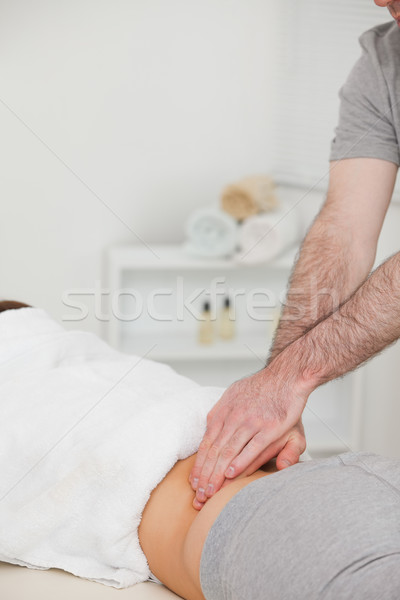 Woman lying while a physiotherapist is massaging her back in a physio room Stock photo © wavebreak_media