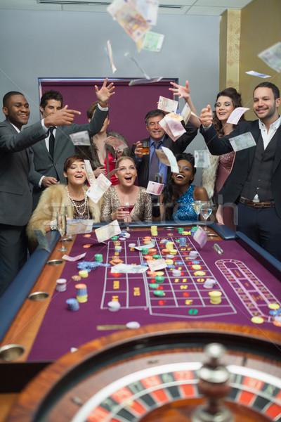 Personas dinero casino feliz champán Foto stock © wavebreak_media