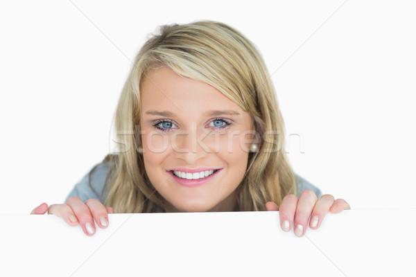 Mosolyog szőke nő néz poszter kéz női Stock fotó © wavebreak_media