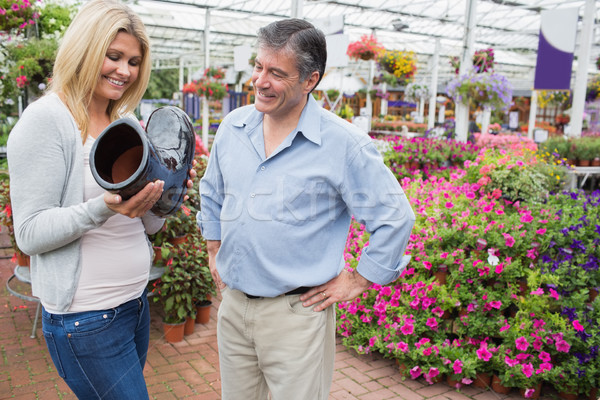 Couple smiling and looking at boot shaped flower pot in garden center Stock photo © wavebreak_media
