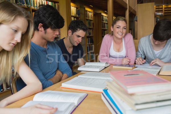 Diákok könyvtár tanul együtt körül asztal Stock fotó © wavebreak_media