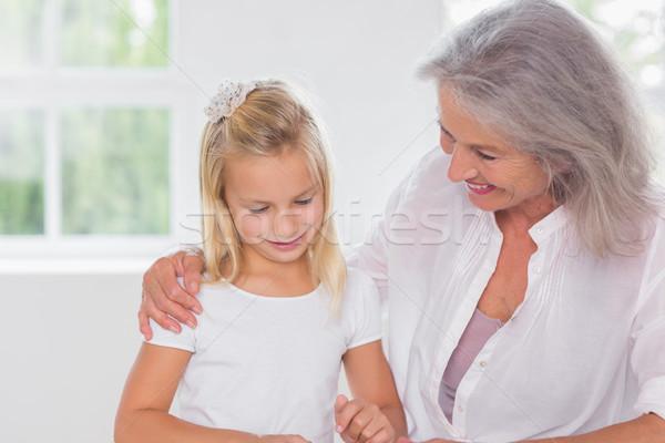 Nagymama beszél leányunoka bent ház boldog Stock fotó © wavebreak_media