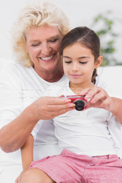Stock photo: Granddaughter and grandmother looking at pictures