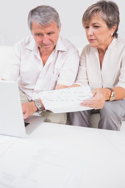 Oude liefhebbers niet met behulp van laptop vergadering kamer Stockfoto © wavebreak_media