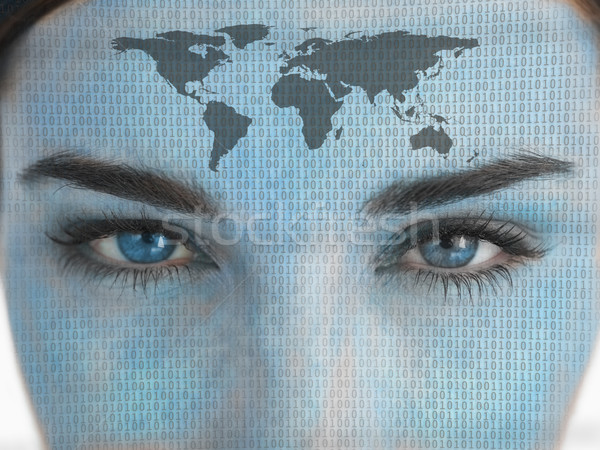 Attractive blue eyed woman with binary coding and map on face Stock photo © wavebreak_media