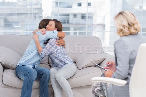 Young couple cuddling on the couch Stock photo © wavebreak_media