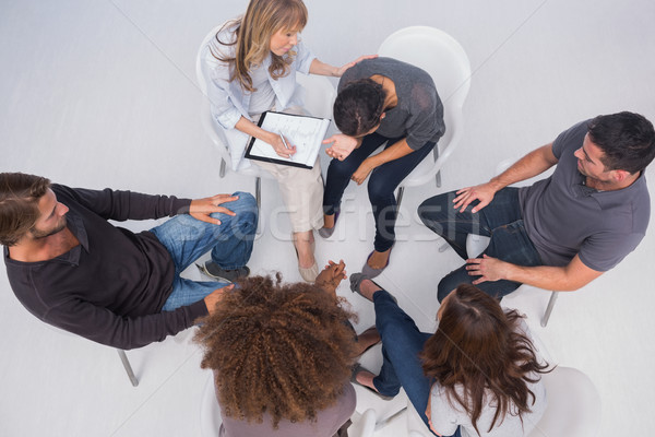 Overhead of group therapy session Stock photo © wavebreak_media