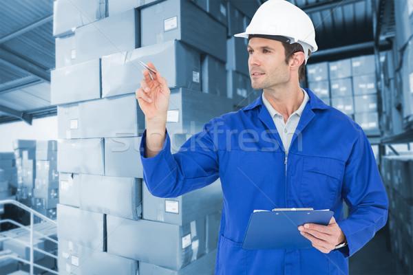 Composite image of supervisor inspecting while holding clip boar Stock photo © wavebreak_media