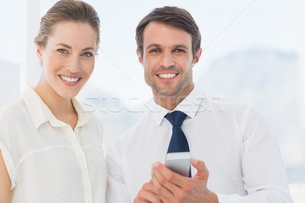 Smartly dressed colleagues with a mobile phone Stock photo © wavebreak_media