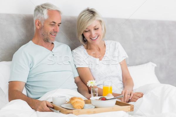 Gelukkig paar ontbijt bed volwassen home Stockfoto © wavebreak_media