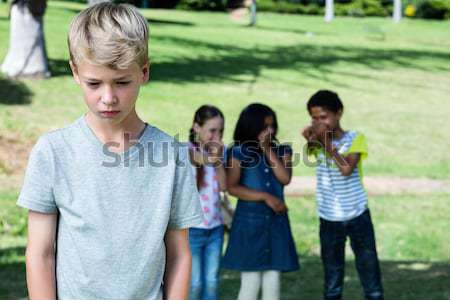 Stock photo: Angry woman with man and girlfriend in background at park