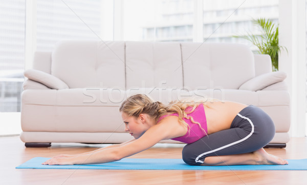 Fit blonde doing pilates on exercise mat Stock photo © wavebreak_media