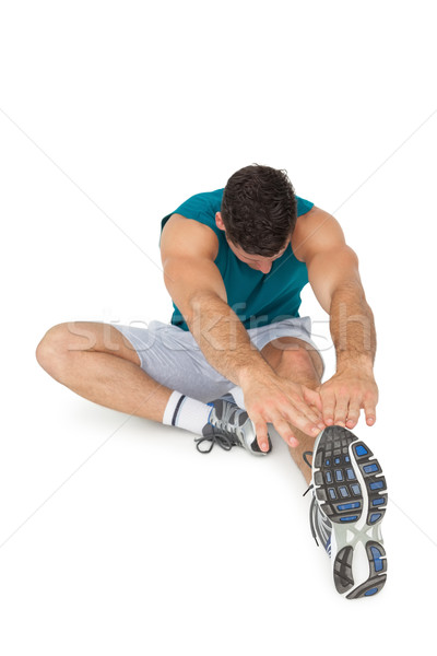 Full length of a fit young man doing stretching exercise Stock photo © wavebreak_media