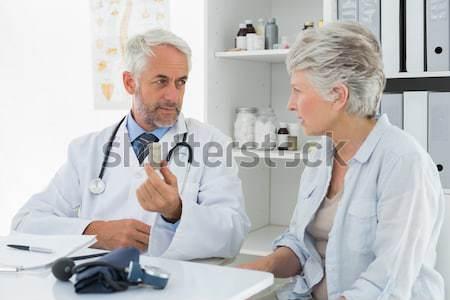 Female doctor talking to senior patient in wheelchair Stock photo © wavebreak_media