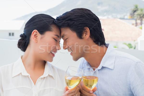 Feliz casal vinho branco fora varanda casa Foto stock © wavebreak_media