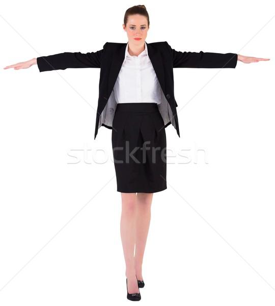 Businesswoman performing a balancing act Stock photo © wavebreak_media
