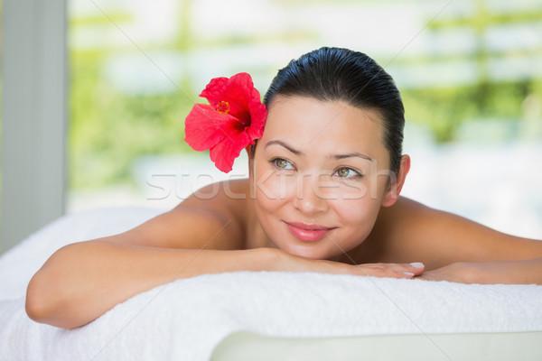 Sorridere bruna massaggio tavola rosso giglio Foto d'archivio © wavebreak_media