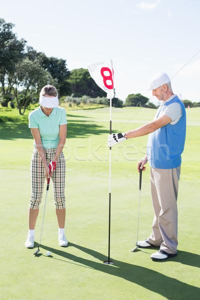 Foto d'archivio: Golfista · buco · bandiera · partner · palla
