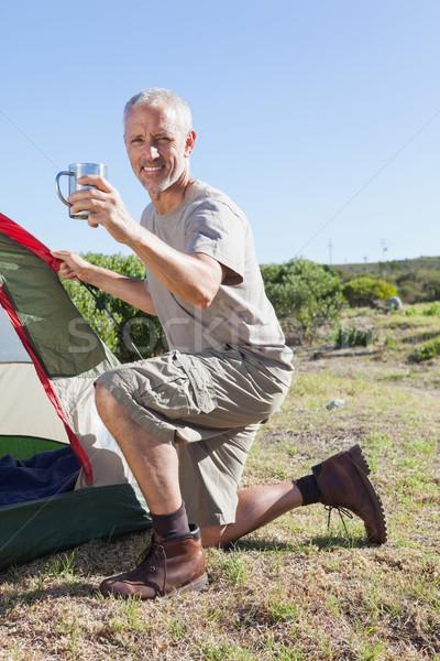 Szczęśliwy w górę namiot trawy Zdjęcia stock © wavebreak_media