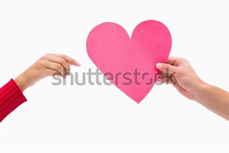 Man passing woman pink heart Stock photo © wavebreak_media