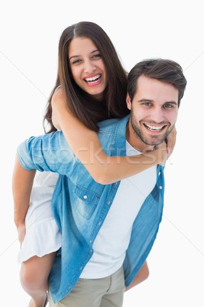 Happy hipster giving his girlfriend a piggy back Stock photo © wavebreak_media