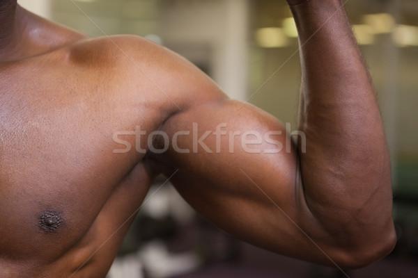 Muscular man flexing muscles Stock photo © wavebreak_media