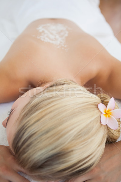 Beautiful blonde lying on massage table with salt scrub treatmen Stock photo © wavebreak_media