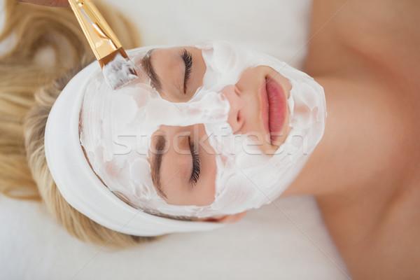 Beautiful blonde getting a facial treatment Stock photo © wavebreak_media