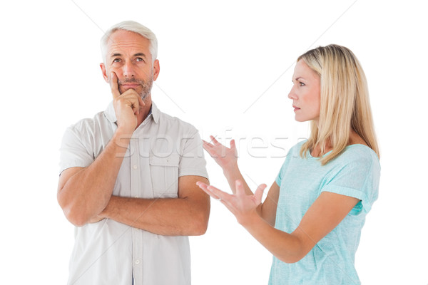 Unhappy couple having an argument with man not listening Stock photo © wavebreak_media