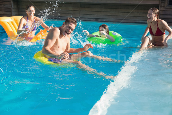 Insanlar oynama yüzme havuzu gençler adam Stok fotoğraf © wavebreak_media