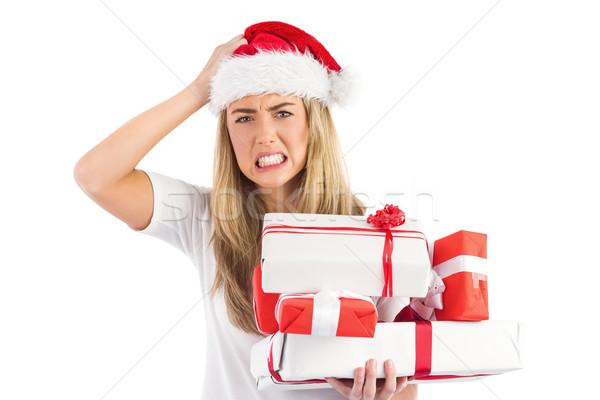 Festive blonde holding pile of gifts Stock photo © wavebreak_media